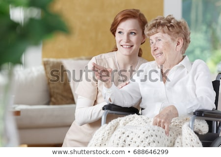 doctor talking to an elderly woman in a wheelchair stock photo © photography33