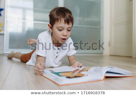 portrait of boy lying stock photo © zzve