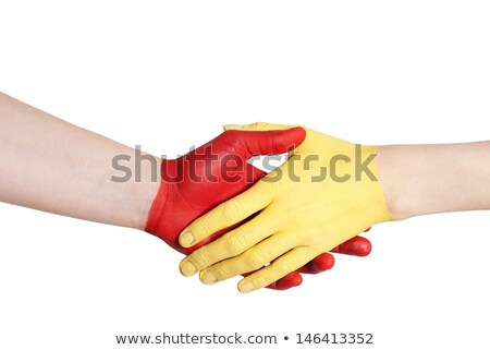 Stock photo: red yellow handshake