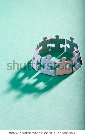 charity concept on green puzzle pieces stock photo © tashatuvango