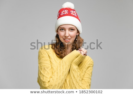 Attractive lady posing with santa cap on stock photo © stockyimages
