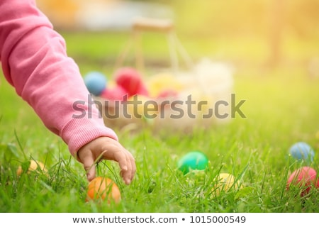Foto stock: Children On Easter Egg Hunt With Eggs