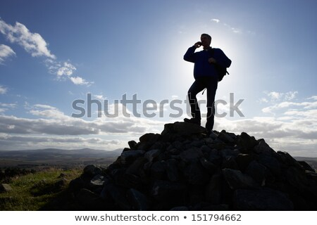 Silhouette homme téléphone portable distant campagne nature Photo stock © monkey_business