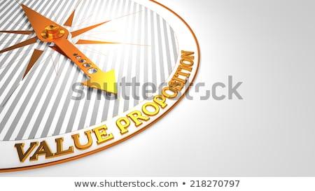 Value Proposition on White with Golden Compass. Stock photo © tashatuvango
