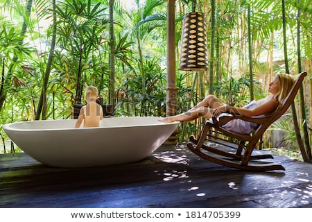 woman in tropical garden having shower outdoors stock photo © dashapetrenko