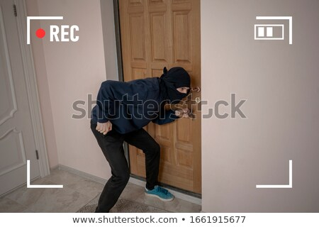 Thief Opening House Door With Tool Stock photo © AndreyPopov