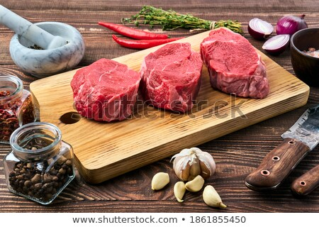 Marinated Steak with Pepper and Knife on a Table Stock photo © ozgur