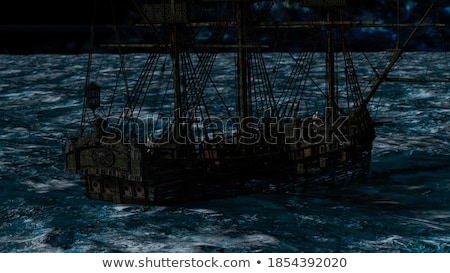Skeletons in a ghost boat by night time Stock photo © ankarb