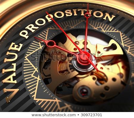 Value Proposition on Black-Golden Watch Face. Stock photo © tashatuvango