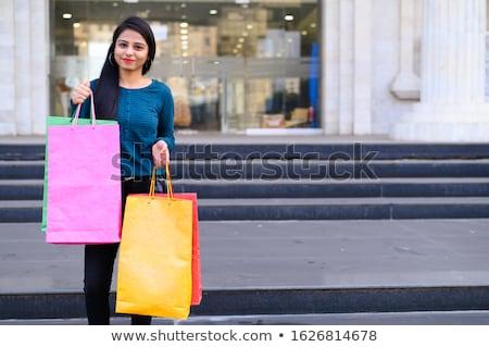 Nő hordoz bevásárlótáskák vásárlás portré áll Stock fotó © imagedb
