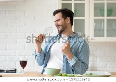 Boldog buli fiatalember iszik élvezi egyedül Stock fotó © lunamarina