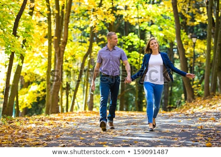 family goes for a walk in the park in autumn stock photo © Paha_L