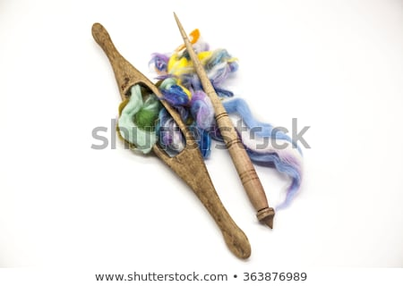 Colored hair and old spindle close-up on wooden background. Tools for knitting of wool Stock photo © mcherevan