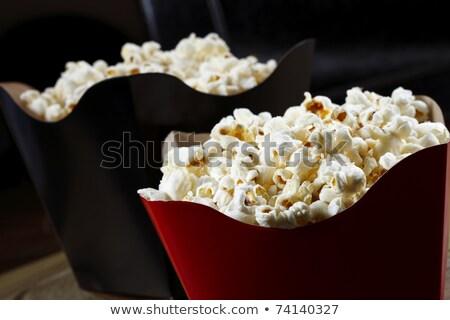 Foto d'archivio: Popcorn · isolato · nero · sale · texture · piatto