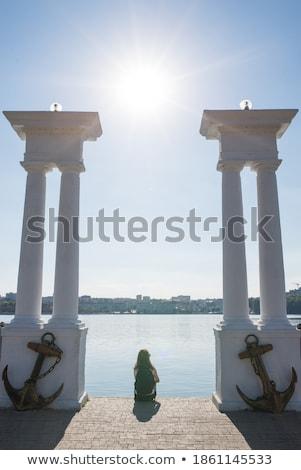 Girl between columns Stock photo © bezikus