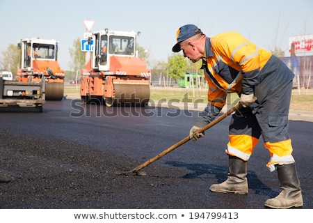 Stock photo: Workers on Asphalting road