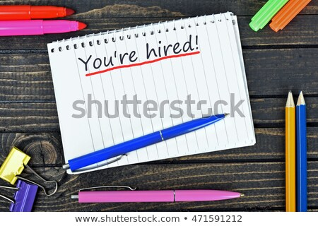 You are Hired word and office tools on wooden table Stock photo © fuzzbones0
