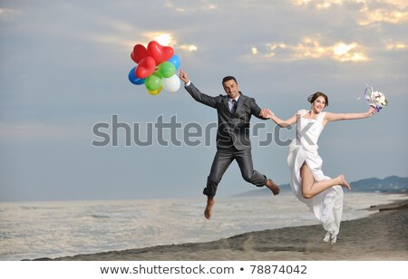 Happy just married young couple celebrating and have fun Stock photo © deandrobot
