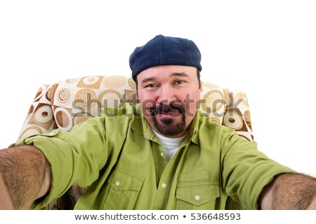 Smiling overweight man in armchair taking selfie Stock photo © ozgur