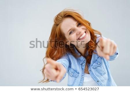 Foto stock: Mulher · indicação · para · cima · sorrir · isolado