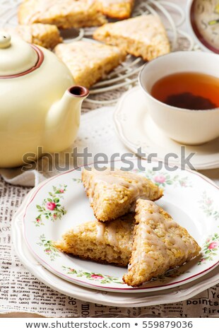 banana scones with cinnamon cream cheese glaze stock photo © zoryanchik