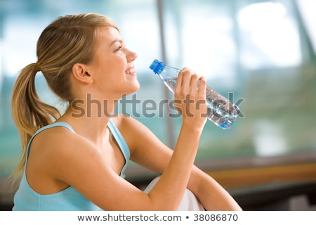 Blonde woman drinking water after working out Stock photo © wavebreak_media