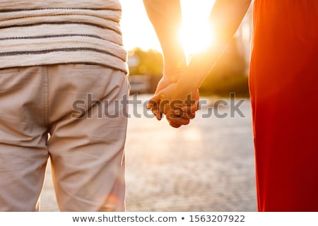 cropped image of two girls holding hands stock photo © deandrobot