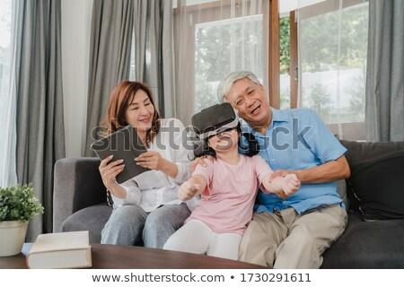 виртуальный реальность счастливым бабушки играет Сток-фото © diego_cervo