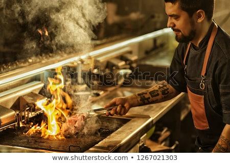 Kaukázusi séf főz hús barbecue grill teljes alakos idős Stock fotó © RAStudio