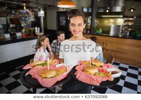 portrait · souriant · serveuse · alimentaire · plateau - photo stock © wavebreak_media