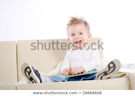 2 years old happy baby boy sitting on sofa Stock photo © chesterf