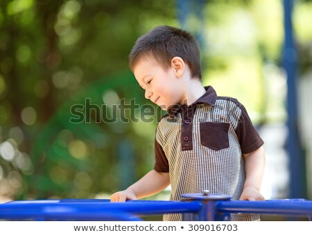 Boldog kicsi fiú körforgalom élvezi napos idő Stock fotó © elly_l