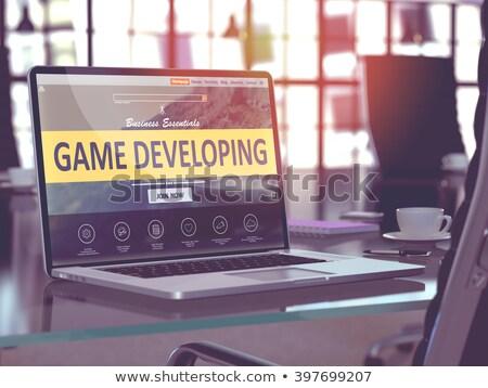 ноутбука экране игры развивающийся современных месте Сток-фото © tashatuvango