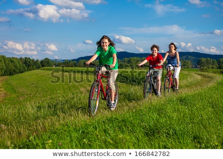 Stock photo: Boy with bike on country lane