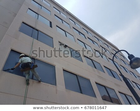 Office worker suspended in mid air Stock photo © IS2