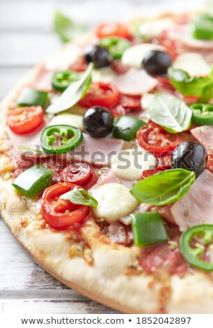 Delicious Pizza with Ham, Olives and Jalapenos Stock photo © zhekos