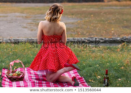 girl on blanket smiling at viewer Stock photo © IS2