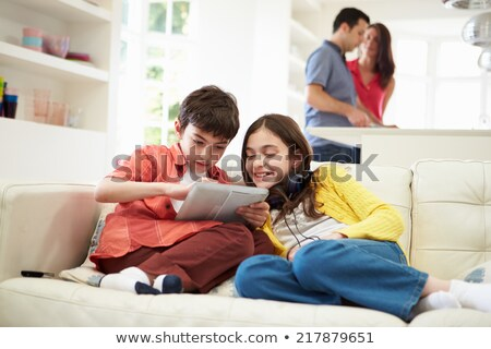 Children playing with an MP3 player Stock photo © IS2