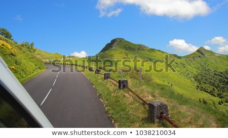 Driving on the road in Puy Mary, volcanic french mountains Stock photo © tilo