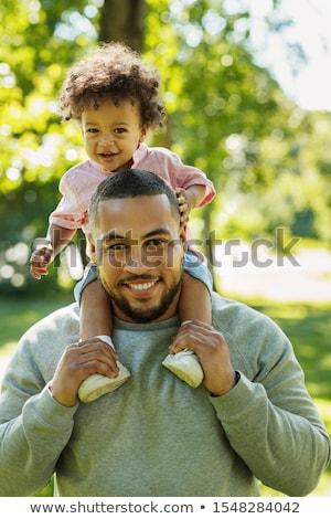 homem · filho · ombros · céu · família - foto stock © is2