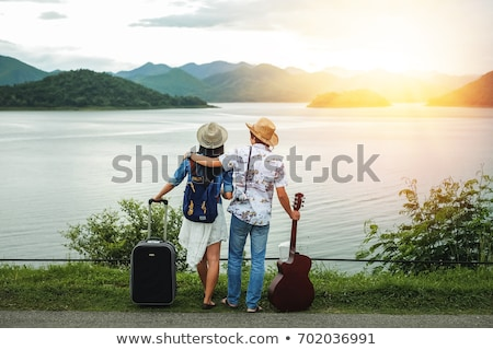 Traveling couple with travel bag and backpack stock photo © studioworkstock
