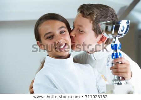 Boy kissing smiling fencing rival Stock photo © IS2