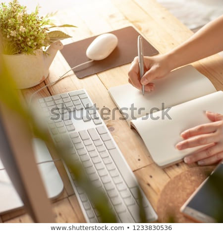 Stock photo: Editor Writing Notes In Diary At Workplace