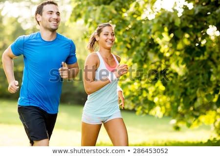 jogging · park · achteraanzicht · jonge · atletisch - stockfoto © boggy