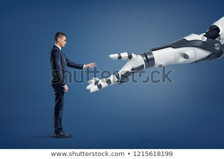 businessman shaking hands with robot, new technology Stock photo © studiostoks