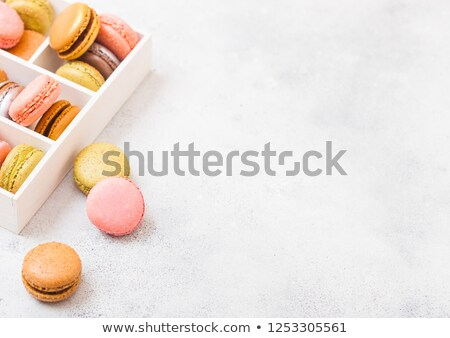 Dessert cake macaron or macaroon on stone kitchen table background. Top view. Space for text. Golden Stock photo © DenisMArt