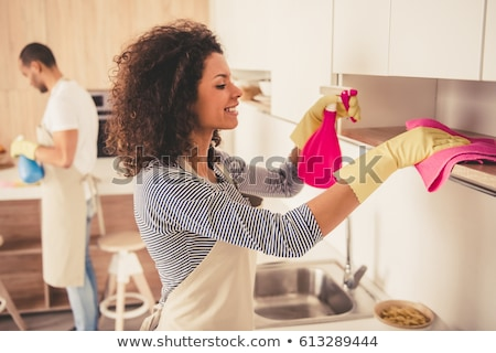 woman or housewife cleaning table at home kitchen Stock photo © dolgachov