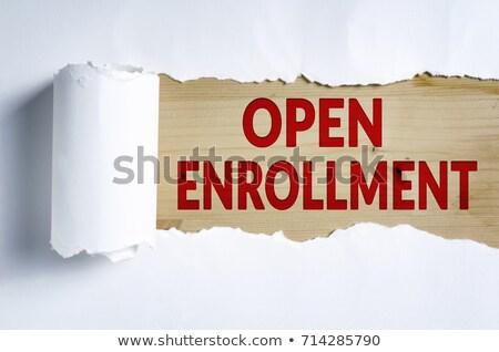 open enrollment torn paper concept stock photo © ivelin