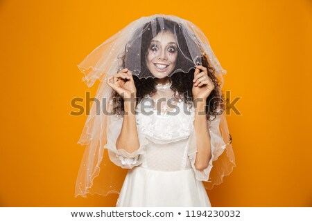 Happy dead bride put on veil and smiling to camera isolated Stock photo © deandrobot