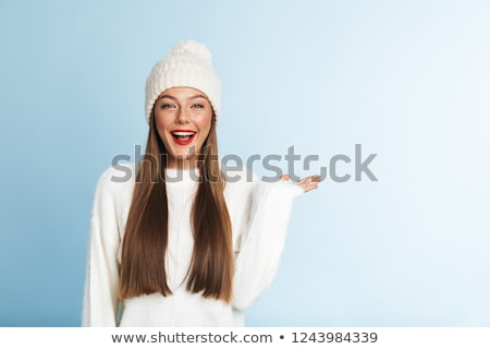 beautiful cute amazing young woman posing isolated over blue wall background showing copyspace stock photo © deandrobot